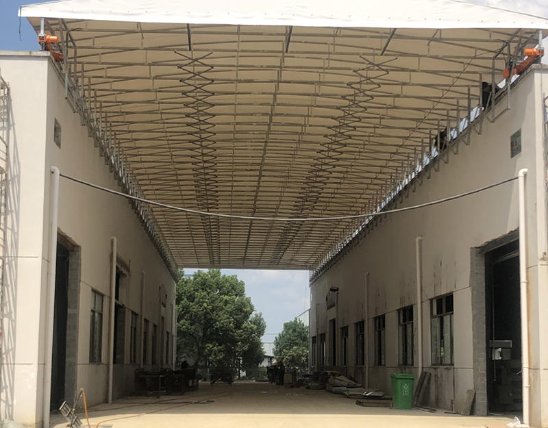 厂房之间伸缩电动雨棚.jpg